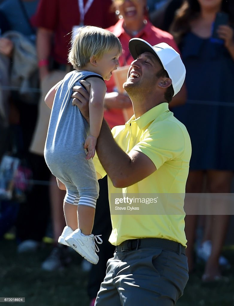Kevin Chappell celebrates with his son Wyatt after putting in to win on the 18th green during the final round of the Valero Texas Open at TPC San Antonio AT&T Oaks Course on April 23, 2017 in San Antonio, Texas.