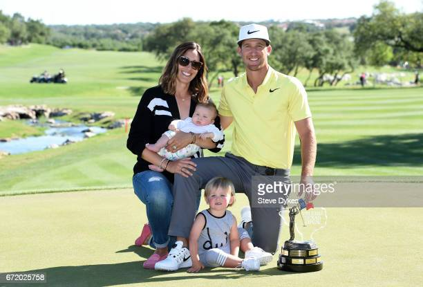 Kevin Chappell celebrates with the trophy and his family wife Elizabeth and children Wyatt and Collins 3 months during the final round of the Valero...