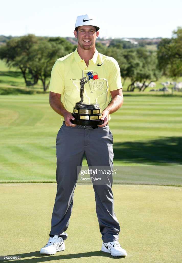 Kevin Chappell celebrates with the trophy during the final round of the Valero Texas Open at TPC San Antonio AT&T Oaks Course on April 23, 2017 in San Antonio, Texas.