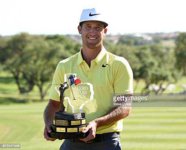 Kevin Chappell celebrates with the trophy during the final round of the Valero Texas Open at TPC San Antonio ATT Oaks Course on April 23 2017 in San...