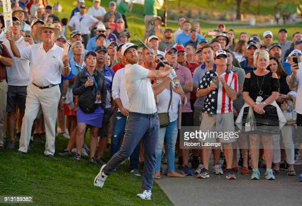 Kevin Chappell hits his second shot on the 18th hole during the first round of the Waste Management Phoenix Open at TPC Scottsdale on February 1 2018...