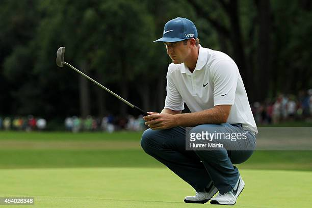 Kevin Chappell lines up a putt on the 18th green during the third round of The Barclays at The Ridgewood Country Club on August 23 2014 in Paramus...
