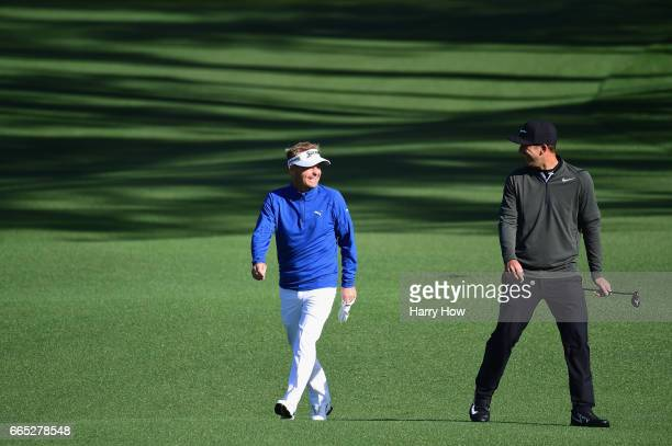 Kevin Chappell of the United States and Soren Kjeldsen of Denmark laugh on the second hole during the first round of the 2017 Masters Tournament at...