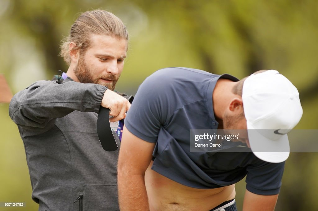 Kevin Chappell of the United States has his back taped on the eighth tee during the third round of the World Golf Championships-Dell Match Play at Austin Country Club on March 23, 2018 in Austin, Texas.