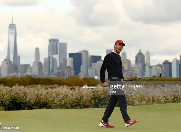 Kevin Chappell of the US team celebrates on the 10th green during Saturday fourball matches of the Presidents Cup at Liberty National Golf Club on...