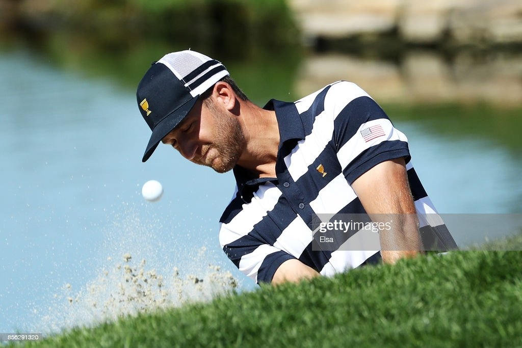 Kevin Chappell of the U.S. Team plays a shot from the bunker for eagle on the second hole to go one up over Marc Leishman of Australia and the International Team during Sunday singles matches of the Presidents Cup at Liberty National Golf Club on October 1, 2017 in Jersey City, New Jersey.