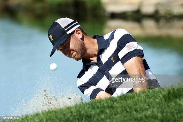 Kevin Chappell of the US Team plays a shot from the bunker for eagle on the second hole to go one up over Marc Leishman of Australia and the...