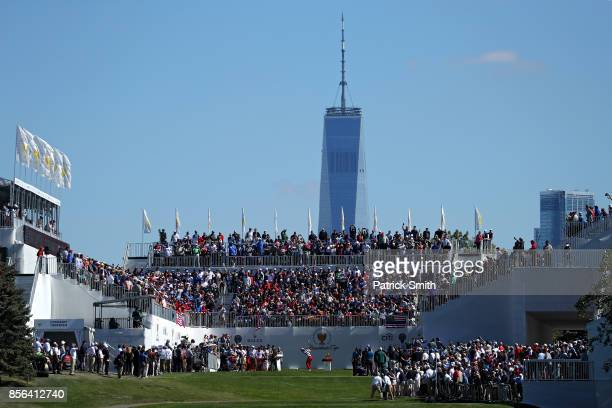 Kevin Chappell of the US Team plays a shot on the first hole during Sunday singles matches of the Presidents Cup at Liberty National Golf Club on...