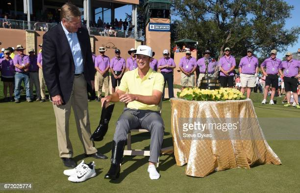 Kevin Chappell tries on the winning pair of cowboy boots after winning during the final round of the Valero Texas Open at TPC San Antonio ATT Oaks...