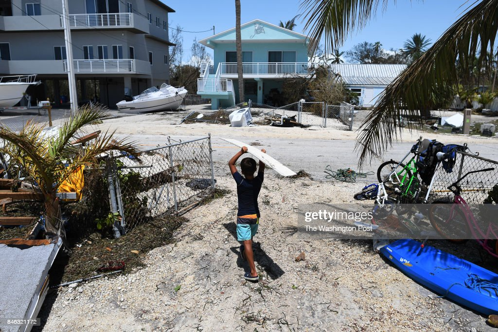Kevin Chavez, 10, helps remove debris from his family's damaged home following Hurricane Irma in the Tavernier area located in the Florida Keys on Tuesday September 12, 2017 in Tavernier, FL. The family was able to get back to see their home for the first time today.