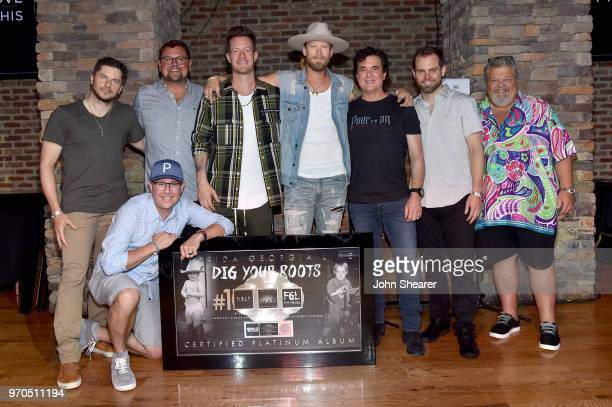Kevin 'Chief' Zaruk Jimmy Harnen Storme Warren Tyler Hubbard Brian Kelley Scott Borchetta Seth England and Craig Wiseman attend the Florida Georga...