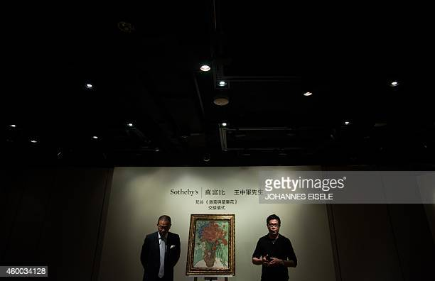 Kevin Ching CEO of Sotheby's Asia and Wang Zhongjun chairman of the highpowered Huayi Brothers film studio stand next to the Vincent van Gogh 1890...