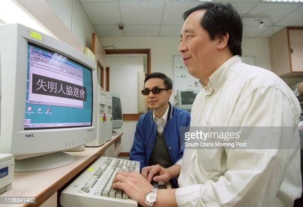 Kevin Chow Kin-chun , Consultation Group Chairman of the Hong Kong Blind Union, and Yuen Kin-ming, Executive Committee Member, operating a computer...