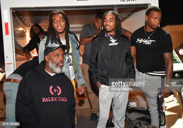 Kevin 'Coach K' Lee Takeoff and Quavo of The Group Migos attends The Migos Turkey Drive at 799 Hutchins Road on November 17 2017 in Atlanta Georgia
