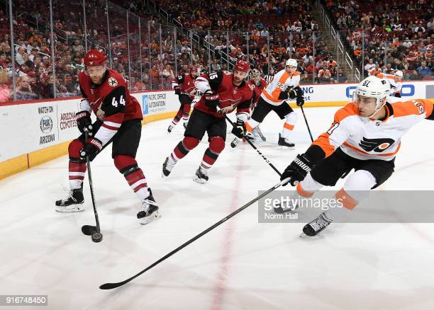 Kevin Connauton of the Arizona Coyotes passes the puck past Valtteri Filppula of the Philadelphia Flyers during the first period at Gila River Arena...