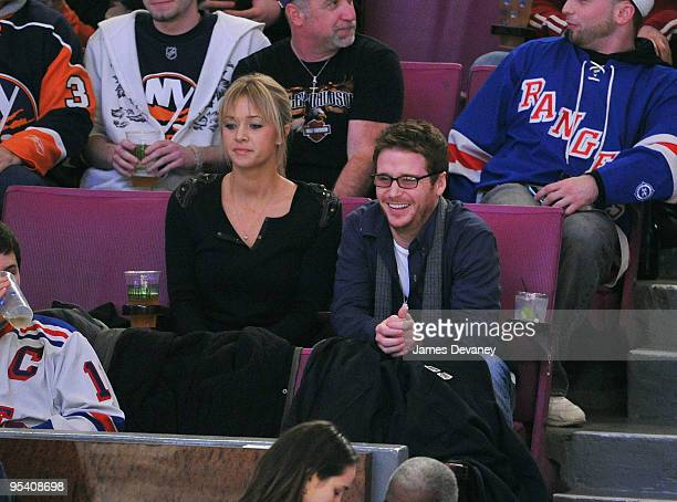 Kevin Connolly and guest attend the New York Islanders vs New York Rangers game at Madison Square Garden on December 26 2009 in New York City