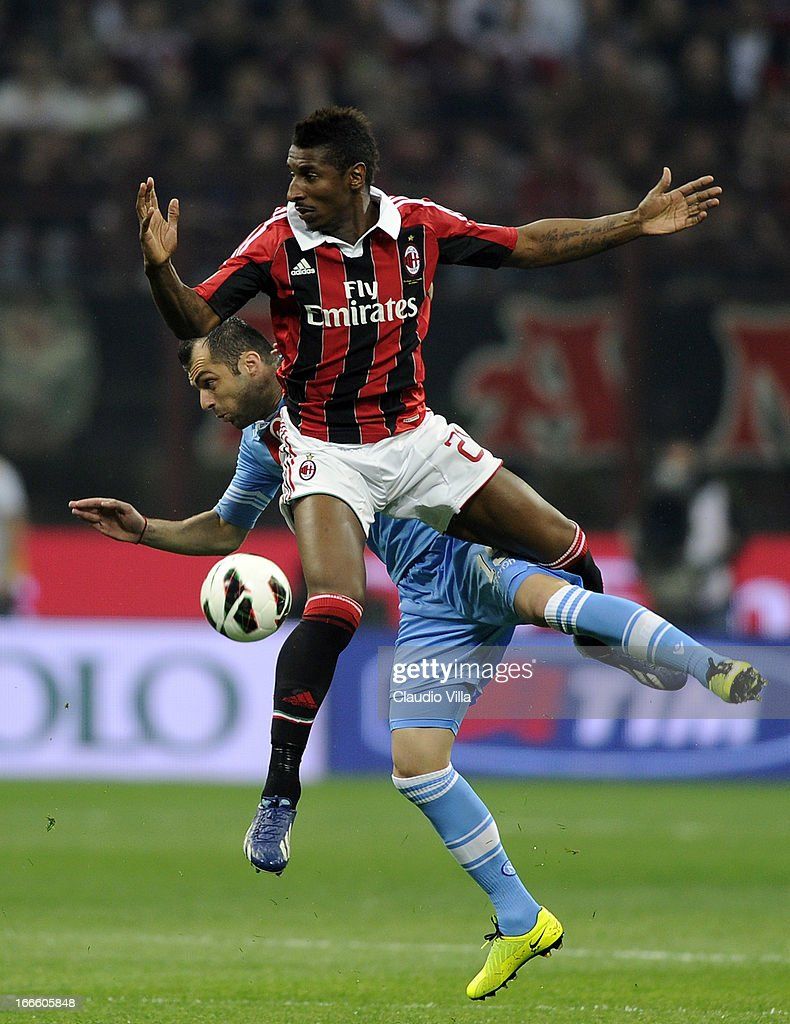 Kevin Constant of AC Milan (R) and Goran Pandev of SSC Napoli compete for the ball during the Serie A match between AC Milan and SSC Napoli at San Siro Stadium on April 14, 2013 in Milan, Italy.