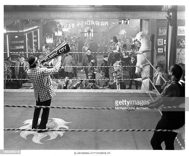 Kevin Conway announces to crowd as Terry Funk Frank McRae and group listen in a scene from the film 'Paradise Alley' 1978