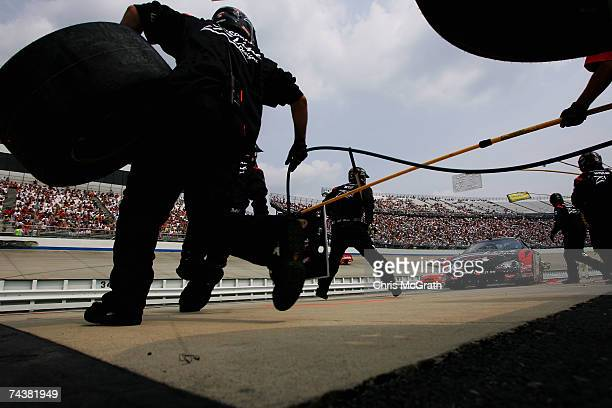 Kevin Conway driver of the ZLine Designs Chevrolet pits during the NASCAR Busch Series Dover 200 on June 2 2007 at Dover International Speedway in...