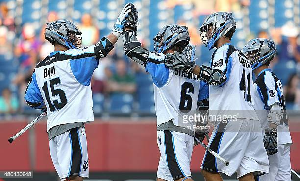 Kevin Cooper of Ohio Machine celebrates his goal with Peter Baum and Steele Stanwick against the Boston Cannons in the first half at Gillette Stadium...