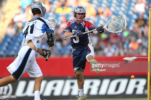 Kevin Cooper of Ohio Machine scores by Jordan Burke of Boston Cannons in the first half at Gillette Stadium on July 11 2015 in Foxboro Massachusetts