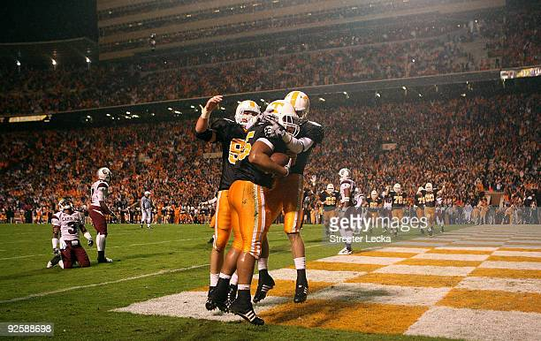 Kevin Cooper of the Tennessee Volunteers celebrates with teammates after scoring a touchdown against the South Carolina Gamecocks at Neyland Stadium...
