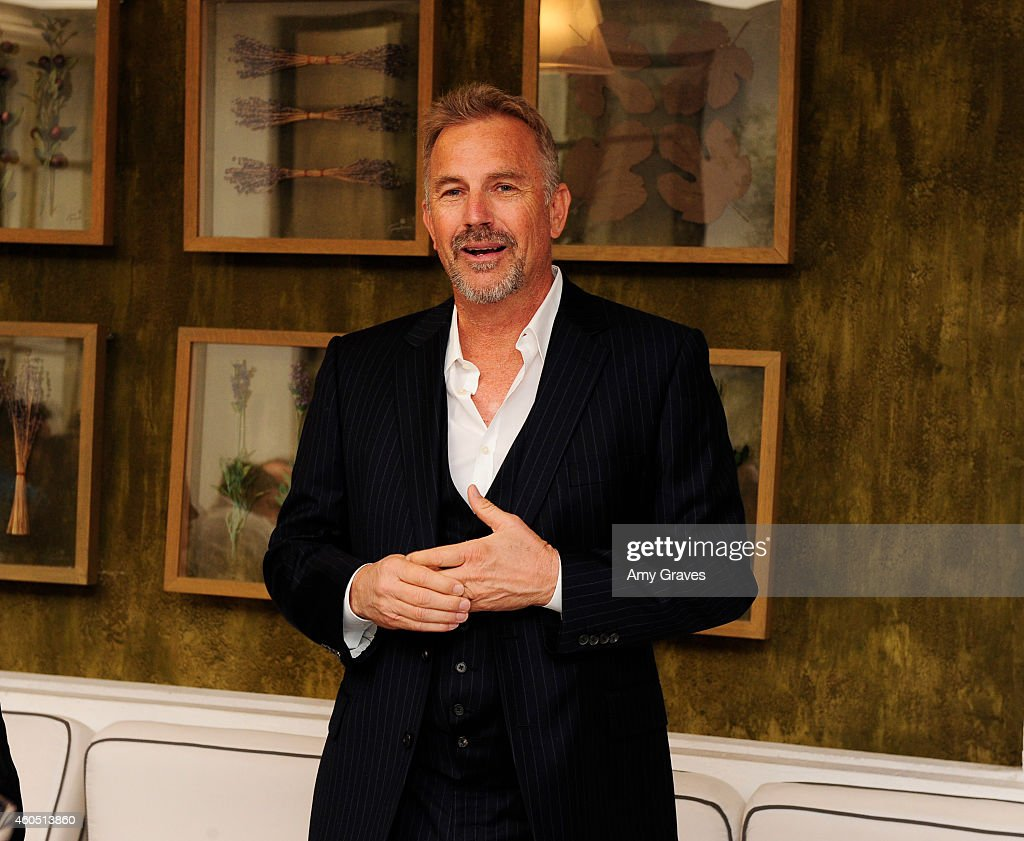 Kevin Costner addresses the gathering at a special luncheon for Kevin Costner and Mike Binder hosted by Colleen Camp for the film BLACK OR WHITE at Fig & Olive Melrose Place on December 15, 2014 in West Hollywood, California.