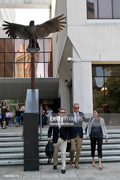 Kevin Costner and Annie Costner seen departing with a member of his legal team at the US District Court Eastern District Of Louisiana on June 13 2012...