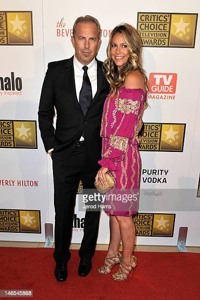 Kevin Costner and Christine Baumgartner arrive at the Critics' Choice Television Awards at The Beverly Hilton Hotel on June 18 2012 in Beverly Hills...