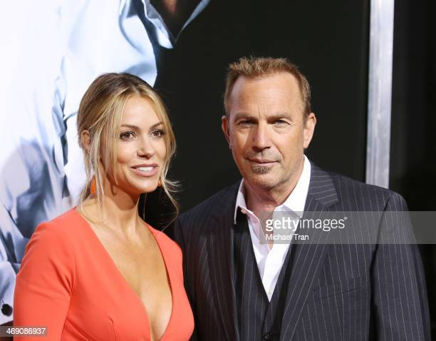 Kevin Costner and Christine Baumgartner arrive at the Los Angeles premiere of 3 Days To Kill held at ArcLight Cinemas on February 12 2014 in...