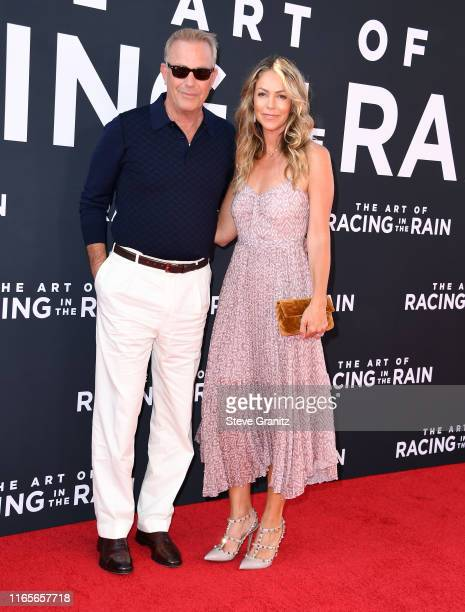 Kevin Costner and Christine Baumgartner arrives at the Premiere Of 20th Century Fox's The Art Of Racing In The Rain at El Capitan Theatre on August...