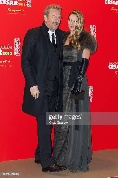 Kevin Costner and Christine Baumgartner attend the Cesar Film Awards 2013 at Le Fouquet's on February 22, 2013 in Paris, France.