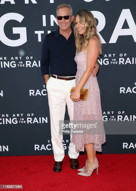 Kevin Costner and Christine Baumgartner attend the Premiere Of 20th Century Fox's The Art Of Racing In The Rain at El Capitan Theatre on August 01...
