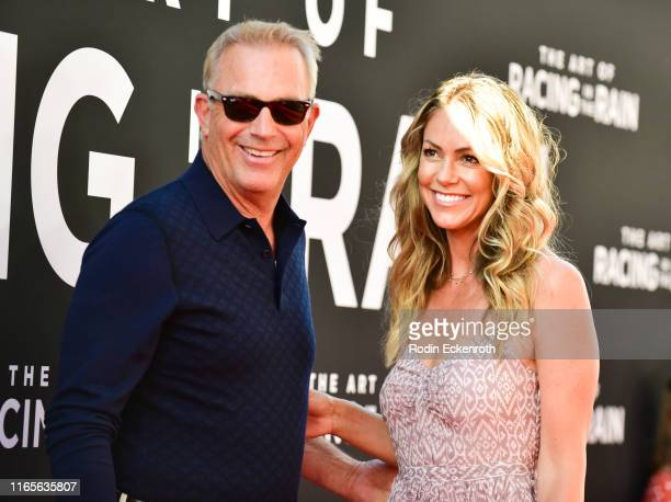 "Kevin Costner and Christine Baumgartner attend the premiere of 20th Century Fox's ""The Art of Racing in the Rain"" at El Capitan Theatre on August 01,..."