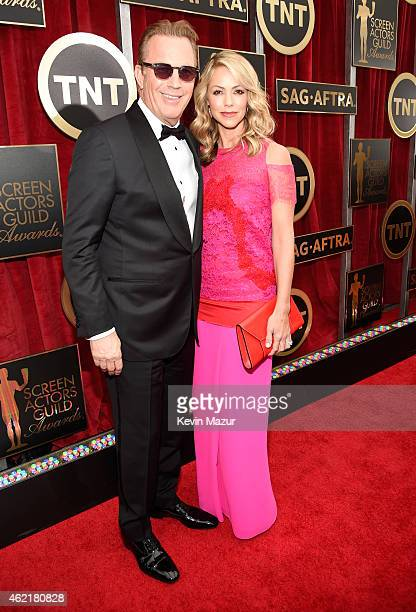 Kevin Costner and Christine Baumgartner attend TNT's 21st Annual Screen Actors Guild Awards at The Shrine Auditorium on January 25 2015 in Los...