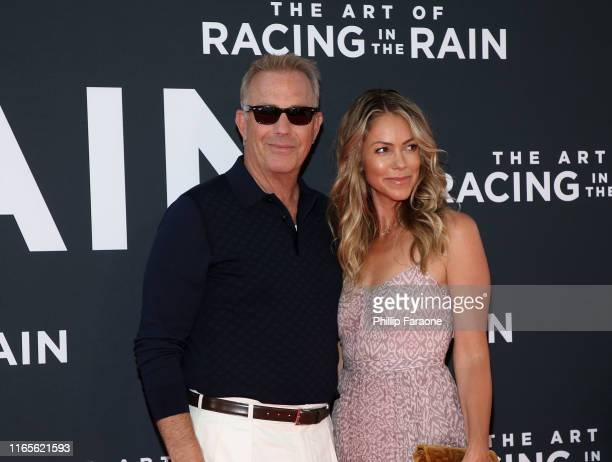 Kevin Costner and Christine Baumgartner attends the Premiere Of 20th Century Fox's The Art Of Racing In The Rain at El Capitan Theatre on August 01...