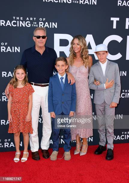 "Kevin Costner and Christine Baumgartner attends the Premiere Of 20th Century Fox's ""The Art Of Racing In The Rain"" at El Capitan Theatre on August..."