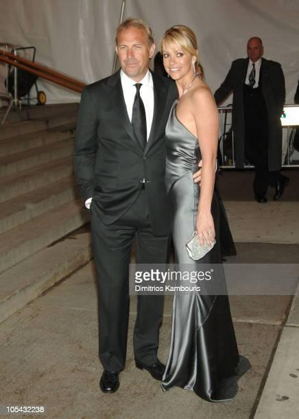 Kevin Costner and Christine Baumgartner during Chanel Costume Institute Gala at The Metropolitan Museum of Art Departures at The Metropolitan Museum...