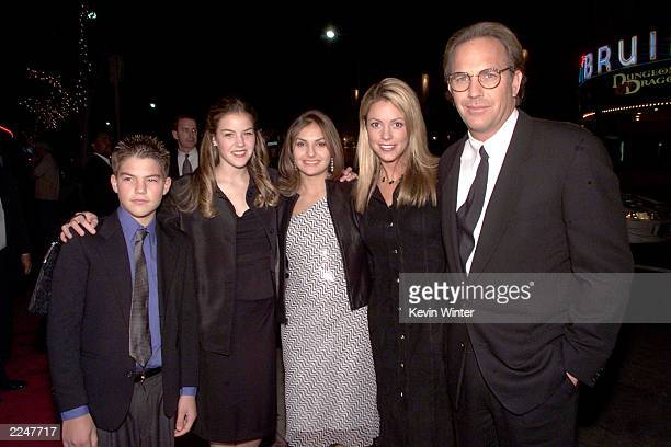 Kevin Costner and Christine Baumgartner with his children Joe Lilly and Annie at the premiere of 'Thirteen Days' at the Village Theater in Los...