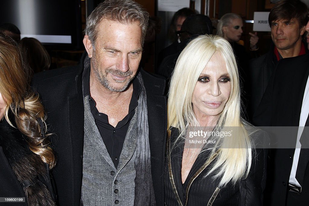 Kevin Costner and Donatella Versace attend the Versace Spring/Summer 2013 Haute-Couture show as part of Paris Fashion Week at Le Centorial on January 20, 2013 in Paris, France.