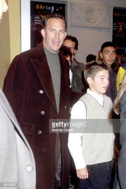 Kevin Costner and his son Joe arrive at the Los Angeles premiere of the new movie Any Given Sunday December 16 1999 in Westwood Ca The movie stars Al...