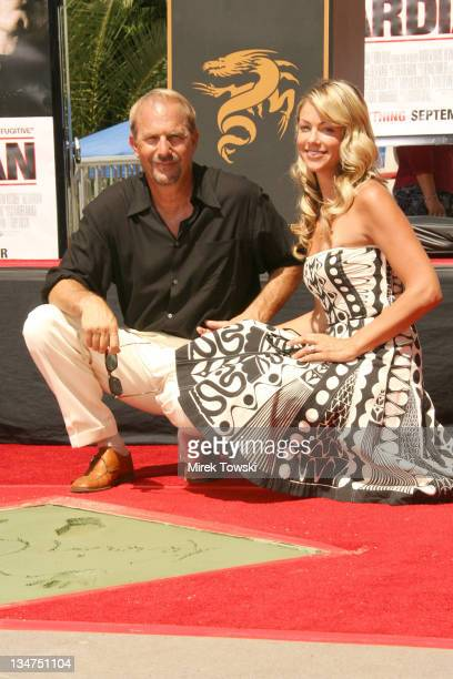 Kevin Costner and his wife Christine Baumgartner during Kevin Costner Handprint Ceremony at Graumann's Chinese Theater in Hollywood CA United States