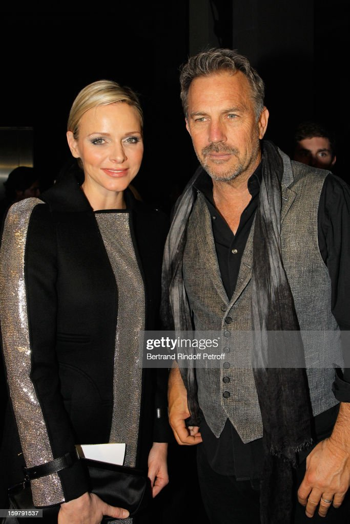 Kevin Costner (R) and Princess Charlene of Monaco attend the Versace Spring/Summer 2013 Haute-Couture show as part of Paris Fashion Week at Le Centorial on January 20, 2013 in Paris, France.