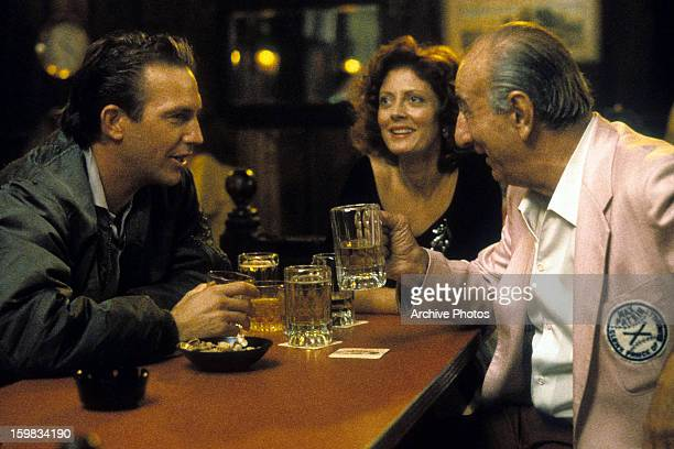 Kevin Costner and Susan Sarandon enjoying drinks at a bar in a scene from the film 'Bull Durham' 1988