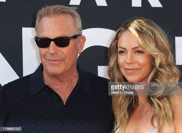 Kevin Costner and wife Christine Baumgartner arrive for the Premiere Of 20th Century Fox's The Art Of Racing In The Rain held at El Capitan Theatre...