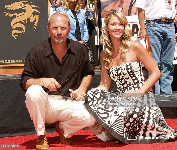 Kevin Costner and wife, Christine Baumgartner during Kevin Costner Honored with a Hand and Footprints Ceremony at Grauman's Chinese Theatre at...