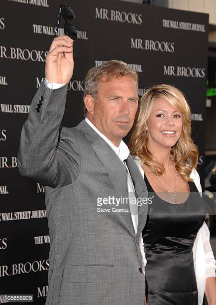 Kevin Costner and wife Christine Baumgartner during Mr Brooks Los Angeles Premiere Arrivals at Grauman's Chinese Theatre in Hollywood California...
