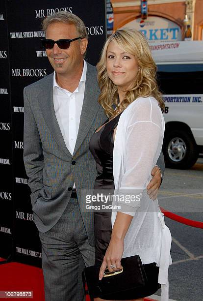 Kevin Costner and wife Christine Baumgartner during 'Mr Brooks' Los Angeles Premiere Arrivals at Grauman's Chinese Theatre in Hollywood California...