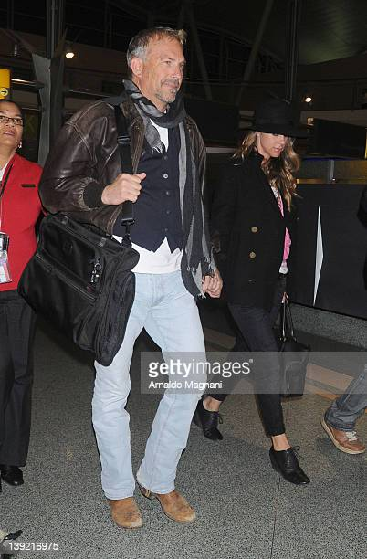 Kevin Costner and wife Christine Baumgartner land at John F Kennedy Airport on February 17 2012 in New York City