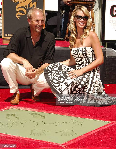 Kevin Costner and Wife Christine during Kevin Costner Hand Footprints Ceremony at Grauman's Chinese Theatre in Hollywood California United States